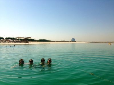 The author and classmates swimming in a man-made gulf along Yas Island in Abu Dhabi.