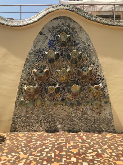 Some of the recycled mosaics used for this wall in the house garden.